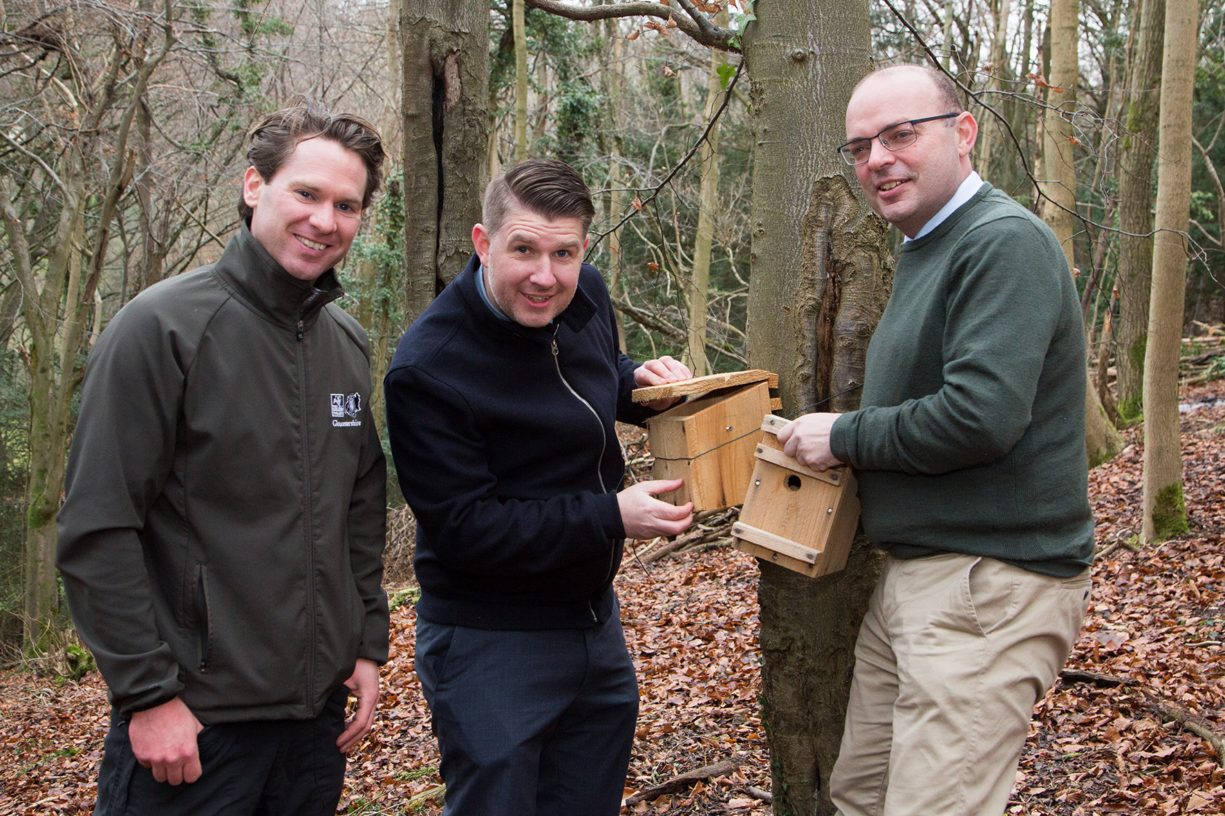 Creating an ideal environment for hazel dormice: Alan Sumnall, Stroud Reserve Manager for the Gloucestershire Wildlife Trust (right); Anthony Foxlee-Brown, Head of Marketing & Communications at Grundon (centre) and Andrew Short, Estates Director at Grundon, install nest boxes at the Laurie Lee Nature Reserve