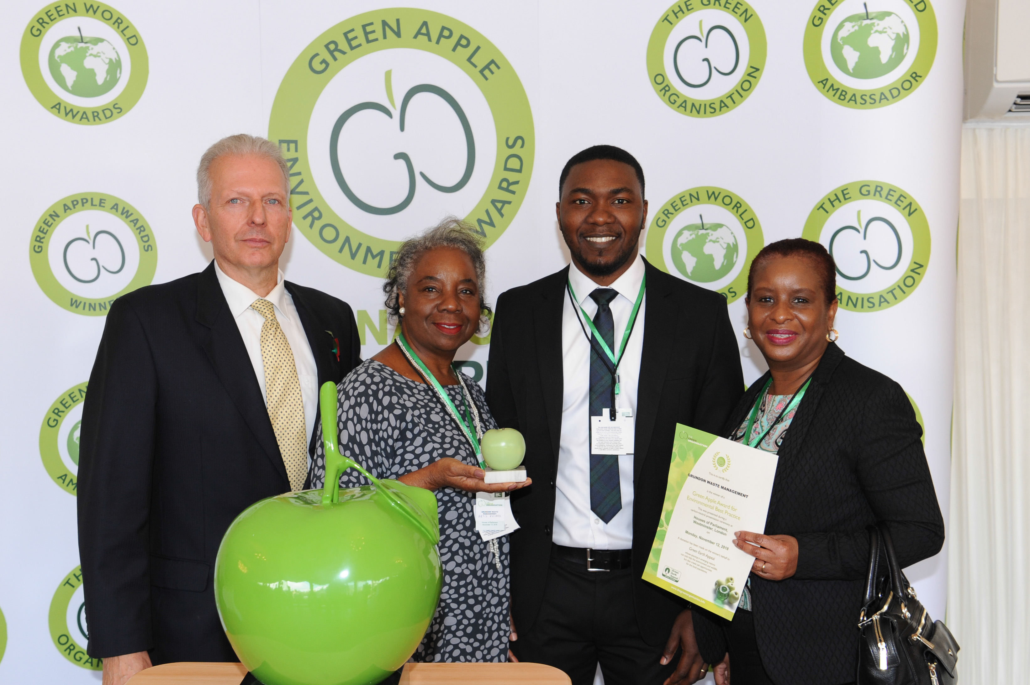 Successful partnership: Grundon's Toye Ogunleye, Waste Manager - NHS Trusts (centre); celebrates with Artis Richard and Brenda Brown from London North West Healthcare NHS Trust after scooping a bronze Green Apple Award in the Health Wastes Management category.