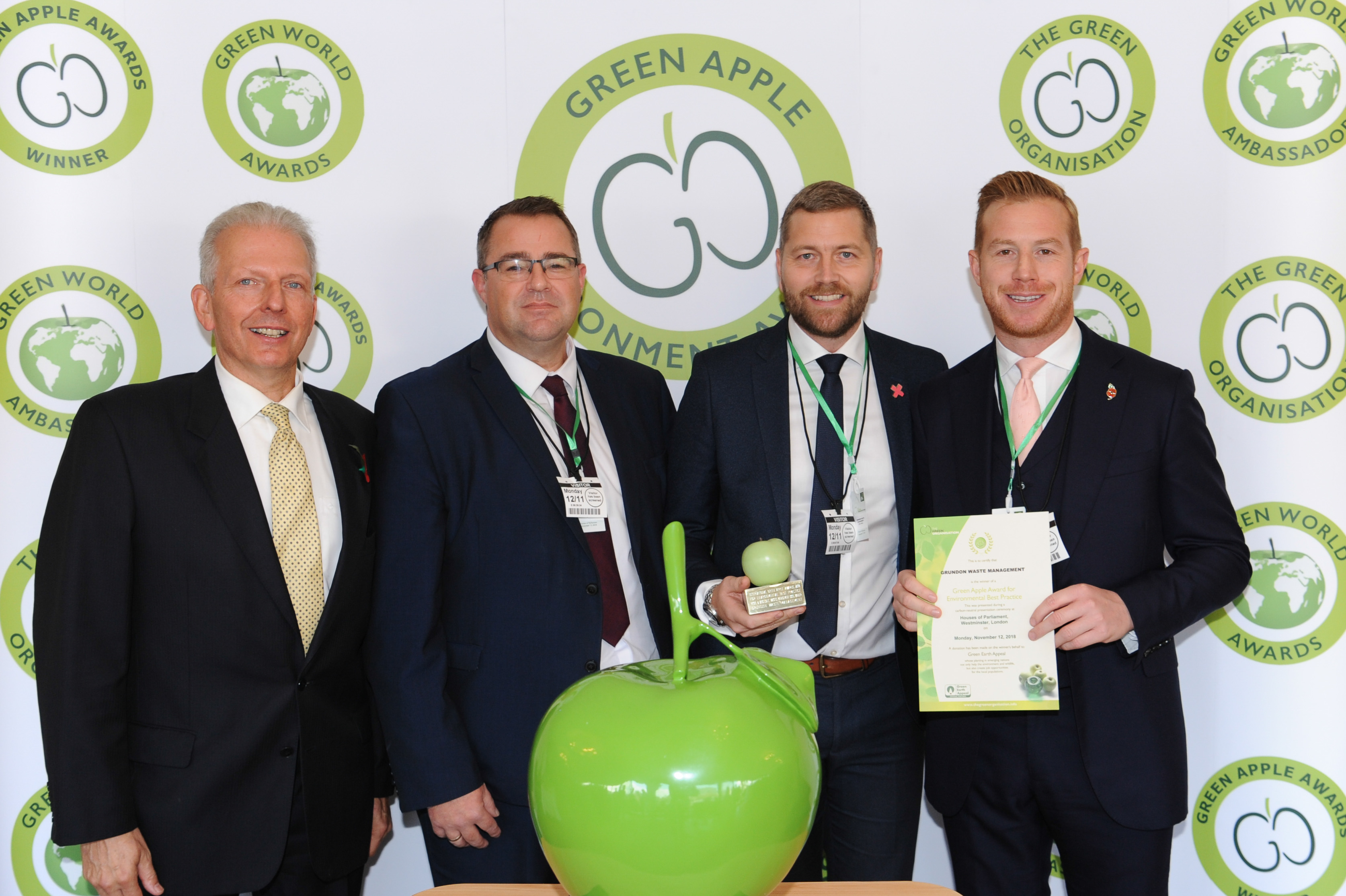 Gold standard: (from second left) Mark Peasley, Contract Manager at Grundon; Carl Meale, General Manager at Savills; and Stephen Hill, Head of Sales at Grundon, celebrate Xscape Milton Keynes taking top honours in the Retail and Wholesale Wastes Management category at the Green Apple Awards.