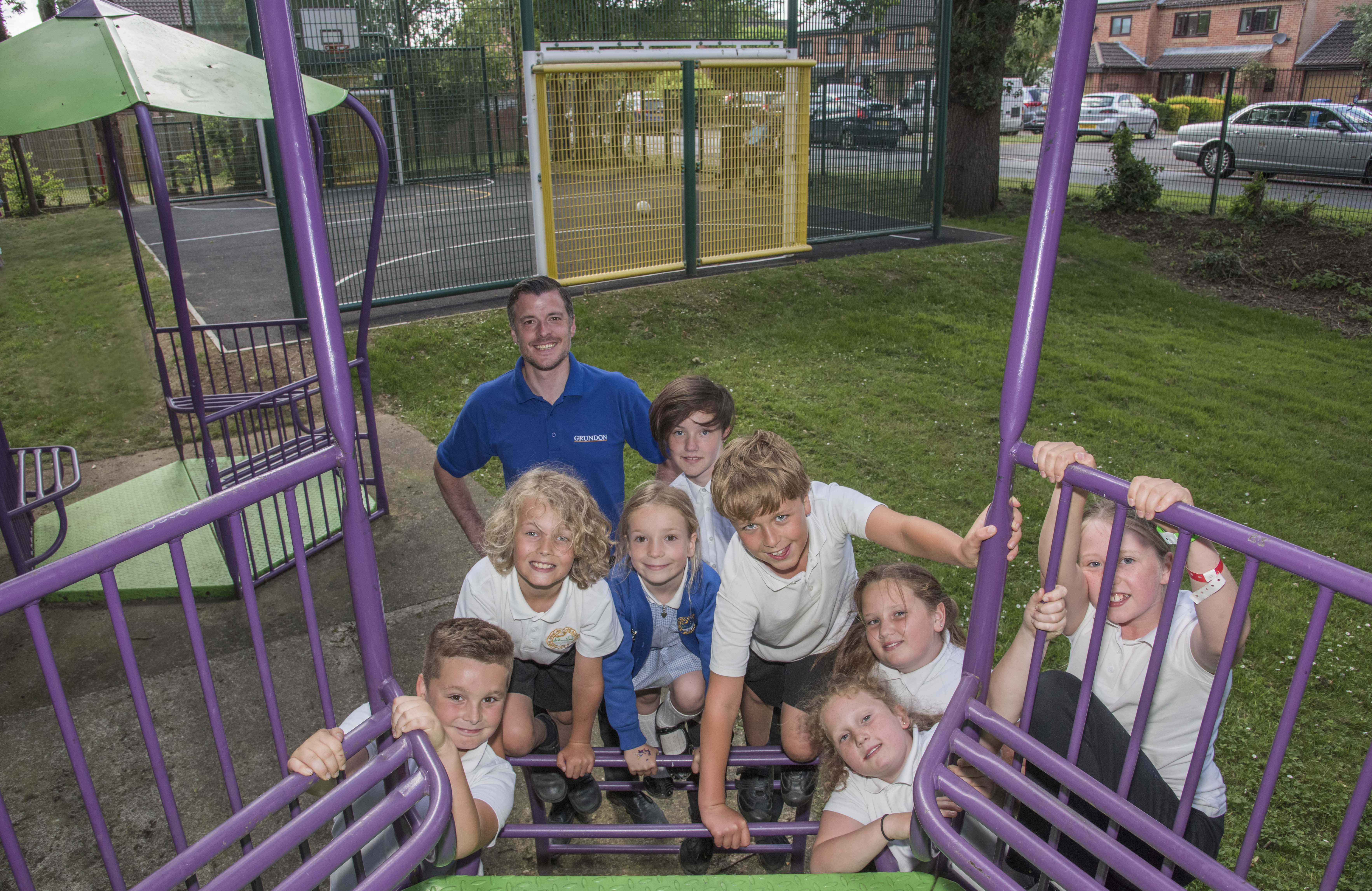 Grundon's Ben Cuthbertson is pictured as local schoolchildren try out the equipment