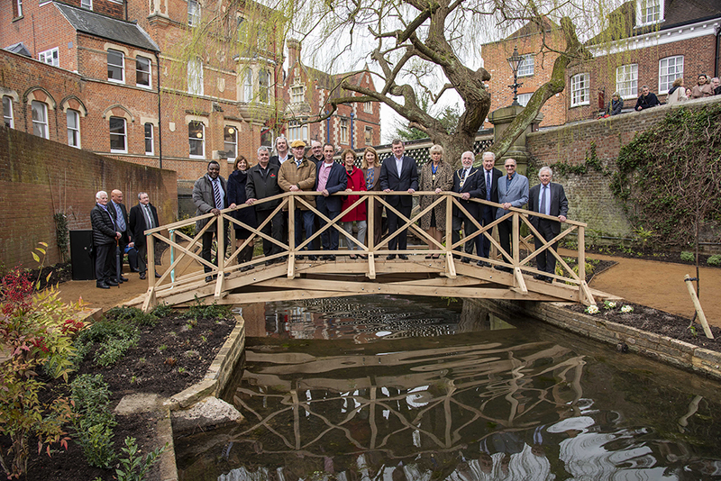 Project supporters gathered for the official opening, including Norman Grundon (wearing a cap), Ros Rivaz (red coat) and Peter Eaton (second from right) with Lord Waldegrave (far right).
