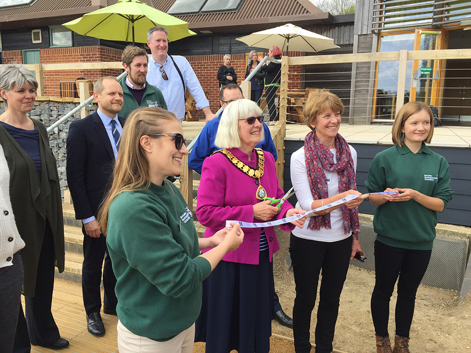 Councillor Jan Cover, Town Mayor of Thatcham 2018-19, prepares to cut the ribbon at the official opening, watched by BBOWT Chairman Barbara Muston (in white) and BBOWT staff, supporters and sponsors.
