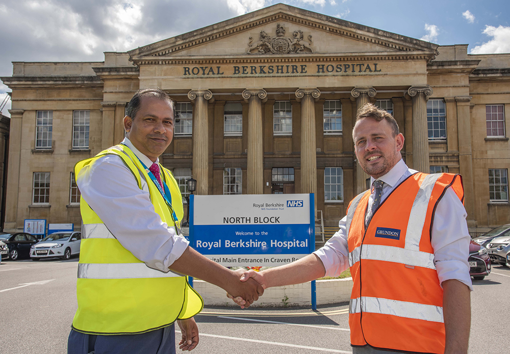 Alberto Povo, Team Leader Portering Services at the Royal Berkshire Hospital (left) with Phil Steer,  Grundon's Commercial Manager - Clinical (right)