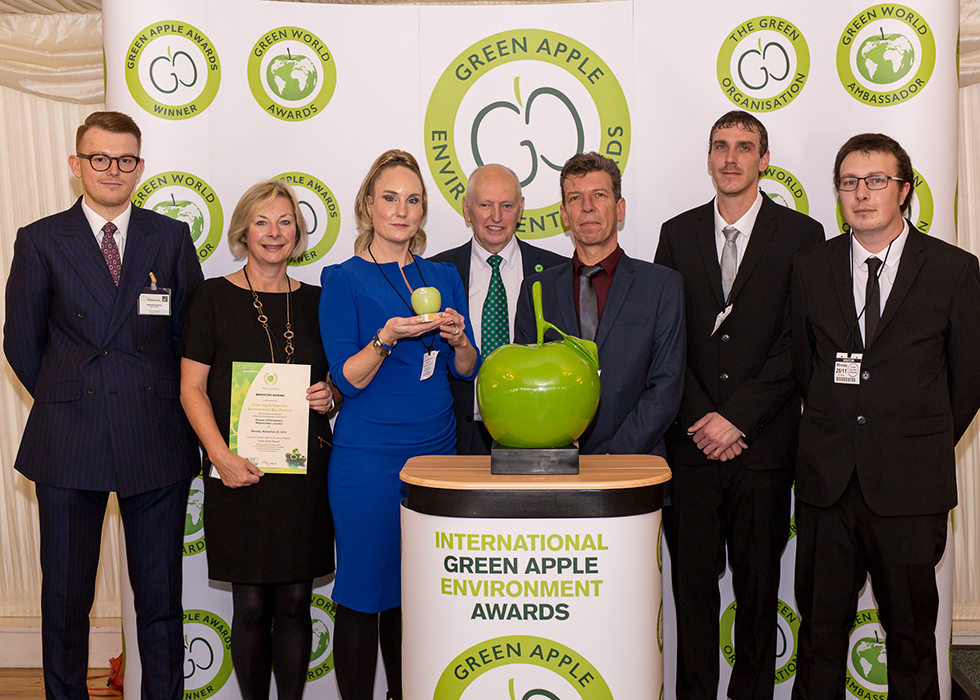 Grundon Waste Management's Andy Piasko, Contract Manager (left) joined the Brighton Marina team, including Kirsty Pollard, Centre Manager (third from left) to collect the Silver Green Apple Award for Environmental Best Practice in the Mixed Use Waste Management category from Roger Wolens, Founder of The Green Apple Awards and Chief Executive Officer of The Green Organisation (centre)