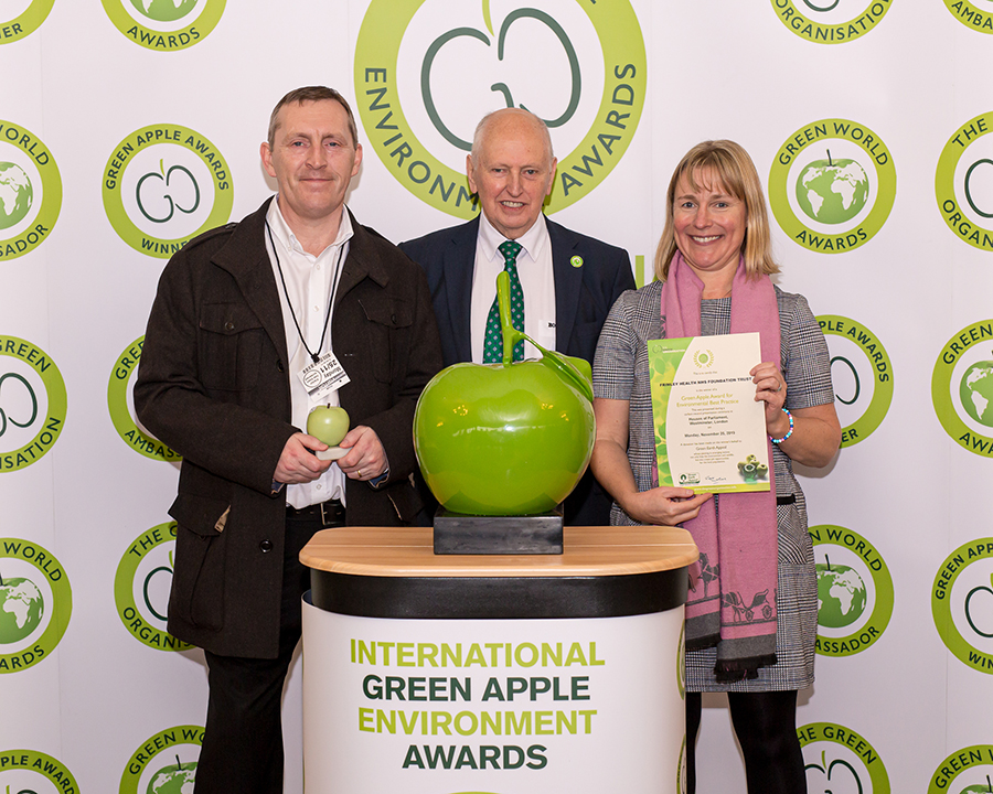 Paul Whitehill, Assistant Hotel Services Manager at the Frimley Health NHS Foundation Trust (left) and Becky Lillywhite, Contract Manager – Clinical at Grundon Waste Management (right), collect the Silver Green Apple Award for Environmental Best Practice in the Wastes Management NHS and Healthcare category from Roger Wolens, Founder of The Green Apple Awards and Chief Executive Officer of The Green Organisation (centre)