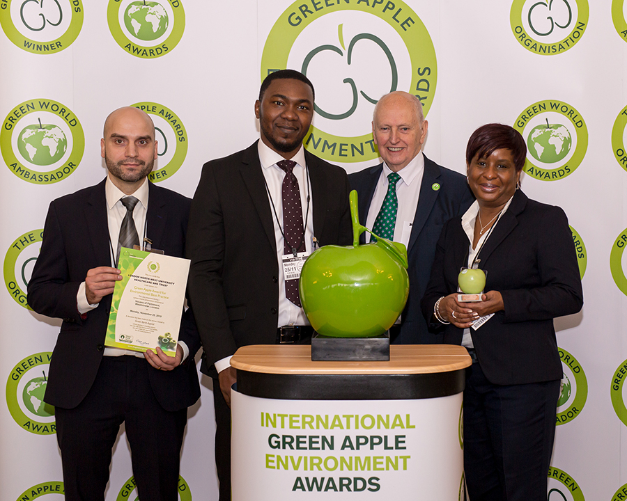 Grundon Waste Management's Joaquim Borges De Abreu and Toye Ogunleye (both left) joined Brenda Brown, Facilities Contracts Manager (right) to collect a second consecutive Bronze Green Apple Award for Environmental Best Practice in the Wastes Management NHS and Healthcare category for the London North West Healthcare (LNWH) NHS Trust from Roger Wolens, Founder of The Green Apple Awards and Chief Executive Officer of The Green Organisation (centre)