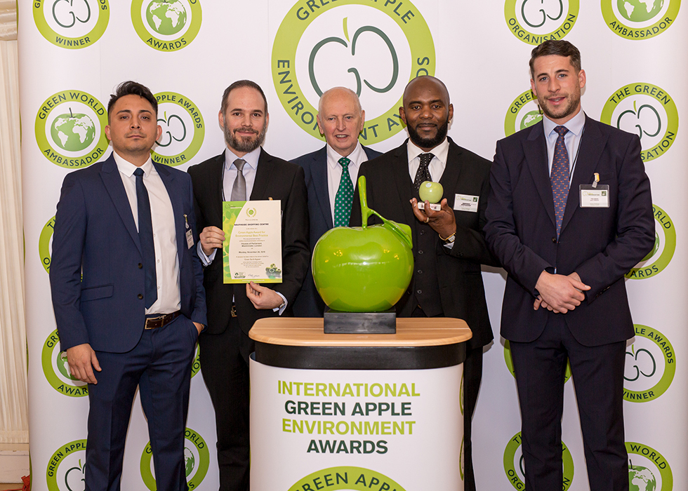 Jack Yarrow, Regional Sales Manager at Grundon Waste Management (right) joined (from the left) Southside Shopping Centre's Nelson Llano Buenano, Pieter Strömbeck and Lenford Jackson, as they collected their Bronze Green Apple Award for Environmental Best Practice in the Retail Waste Management National category from Roger Wolens, Founder of The Green Apple Awards and Chief Executive Officer of The Green Organisation (centre)