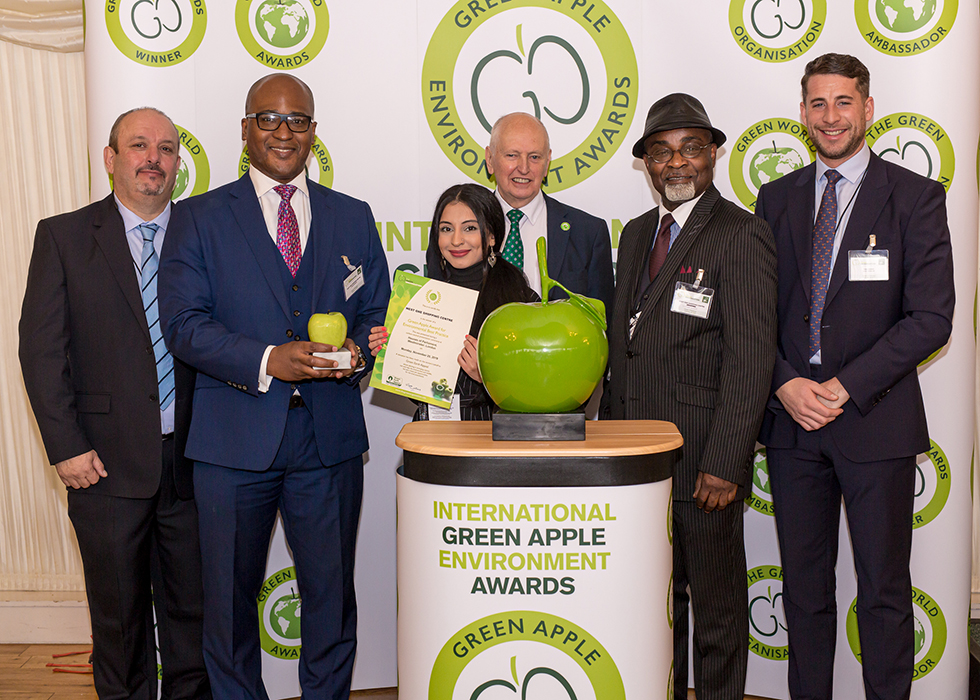 Grundon Waste Management's Regional Sales Manager, Jack Yarrow (right) joined the West One Shopping Centre team including (from right to left) Joaquim Barroca, Cyrus Annan, Farhana Sabir and Victor Nunoo to collect the prestigious Gold Green Apple Award for Environmental Best Practice in the Retail Waste Management Regional category from Roger Wolens, Founder of The Green Apple Awards and Chief Executive Officer of The Green Organisation (centre)