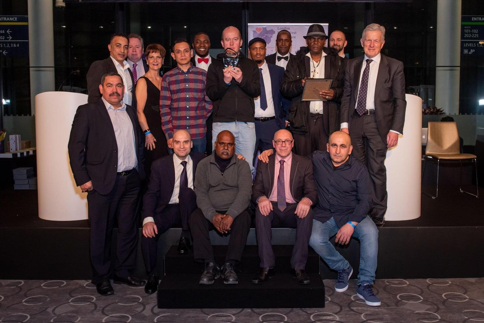 The waste team, which includes waste porters and managers, attended the Trust's Staff Excellence Awards to collect the 'Unsung Hero' award.