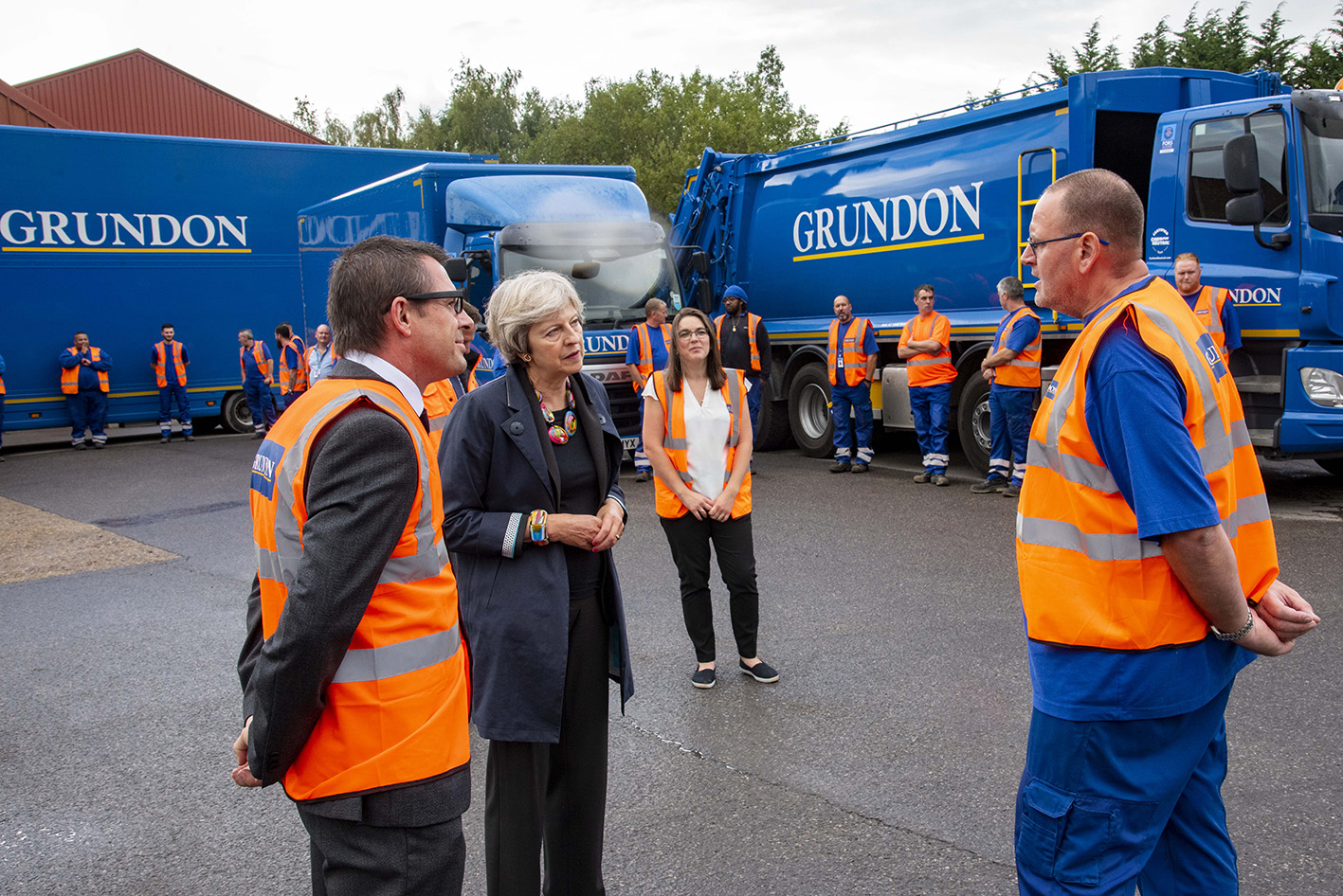 During her visit, Theresa May MP met some of the specialist clinical waste drivers and treatment facility operators, plus other members of the Knowl Hill team, including Mark Padgham (left) and Graham Dunstan (right)