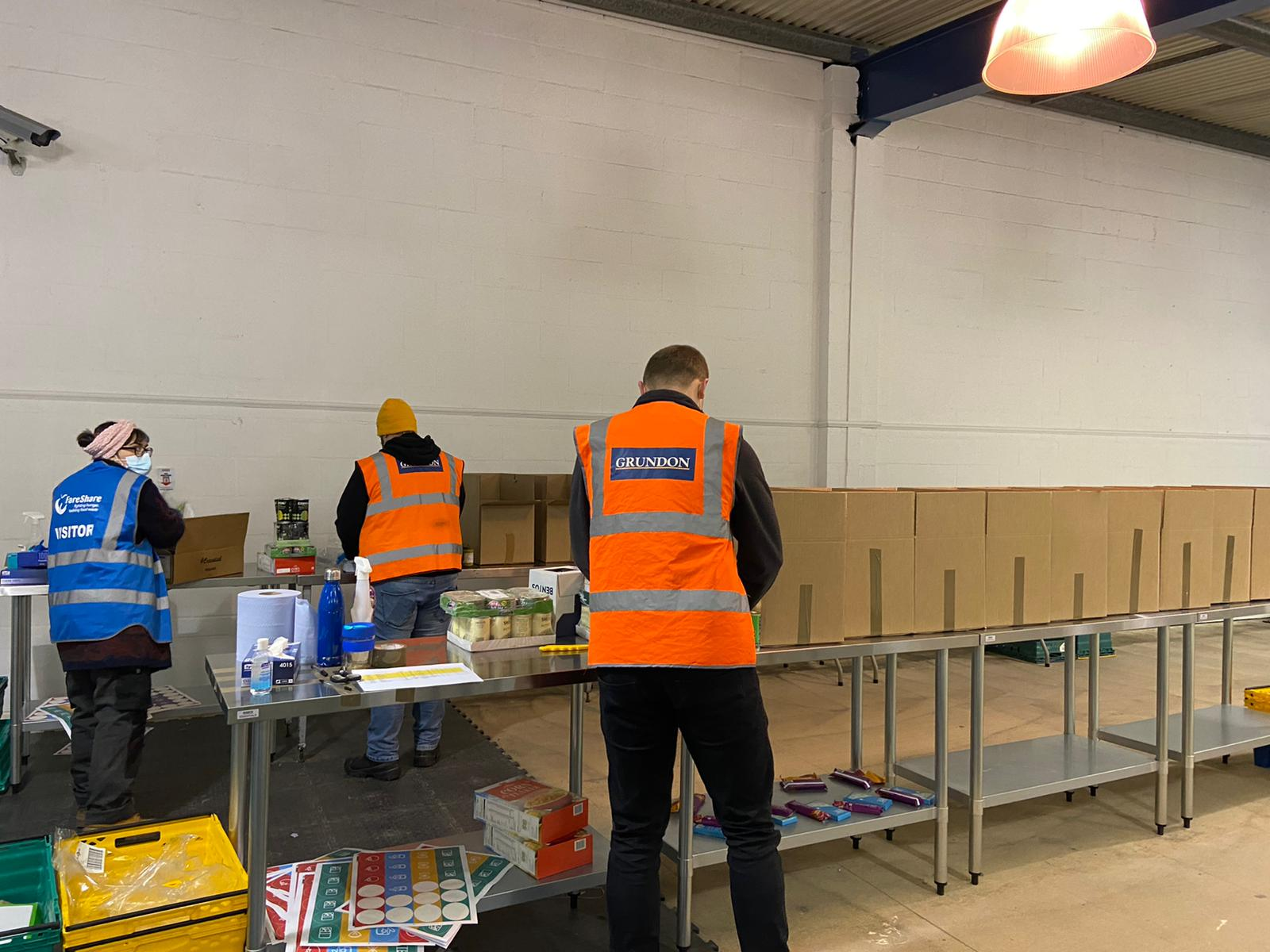 Members of the Grundon team pack food parcels ready for them to be distributed to the local community.