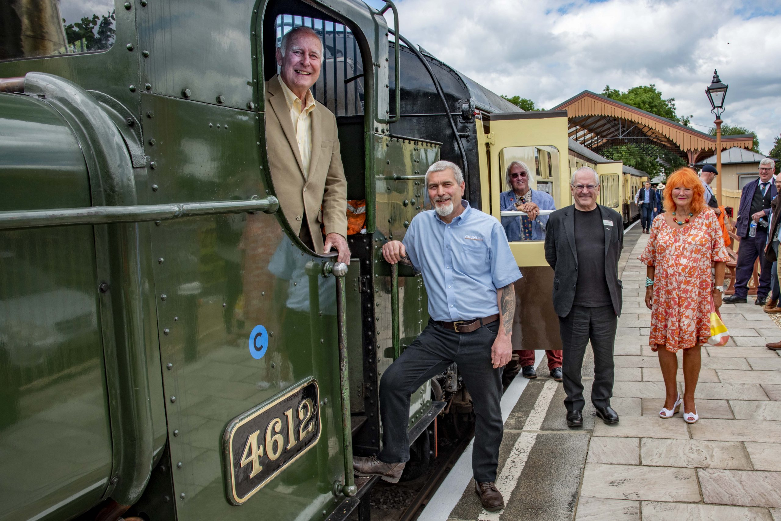 Full steam ahead: (from left) Norman Grundon, Peter Kent, Tony Stead (in background), Sir Peter Hendy CBE and Lady McAlpine.