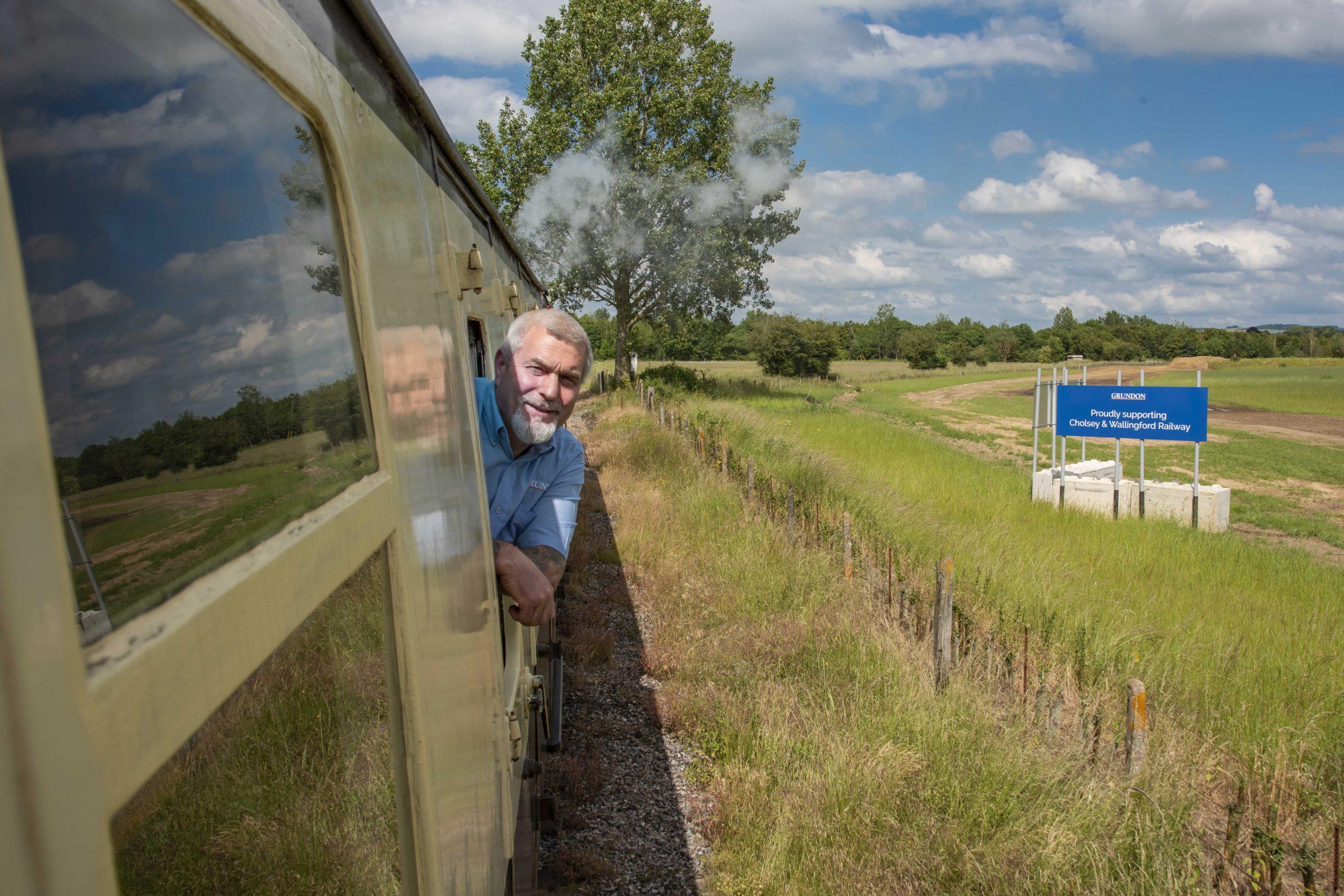 Peter Kent enjoys the view as the train steams post Grundon's New Barn Farm quarry, near Cholsey.
