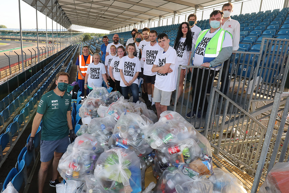 Cleaning up: Sebastian Vettel is pictured with a team of litter pickers at Silverstone after Sunday's race, including Grace Grundon (second from left). © Jakob Ebrey/Silverstone