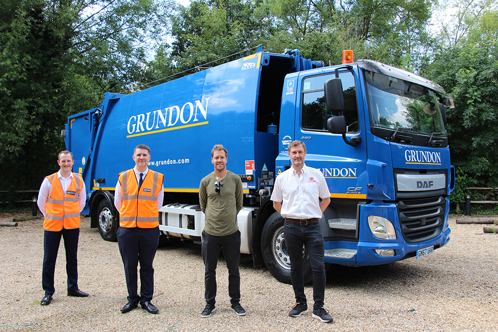 From litter picking to recycling: (From left to right) Grundon's Owen George, Group Development and Innovation Manager; and Anthony Foxlee-Brown, Head of Marketing and Communications, welcomed four-time Formula 1 World Champion Sebastian Vettel and Stephane Bazire, Head of Business Sustainability at Silverstone Circuits Limited to a tour of Grundon's waste treatment facilities in Colnbrook. Sebastian also got a first-hand look at Grundon's ultra-low emission hydrogen/diesel dual-fuel waste collection vehicle