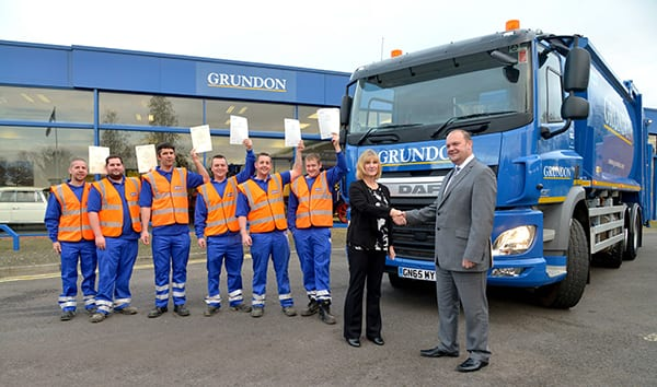 Grundon managing director Clayton Sullivan-Webb celebrates making the shortlist for the Apprenticeships 4 England Employer Awards 2016 with some of Grundon's apprentice drivers