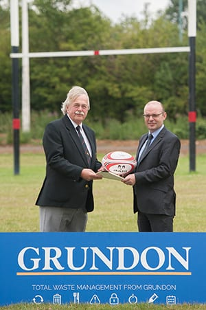 On the ball: Andrew Short (right) hands over the lease for the new pitch to club chairman Paul Balmer.
