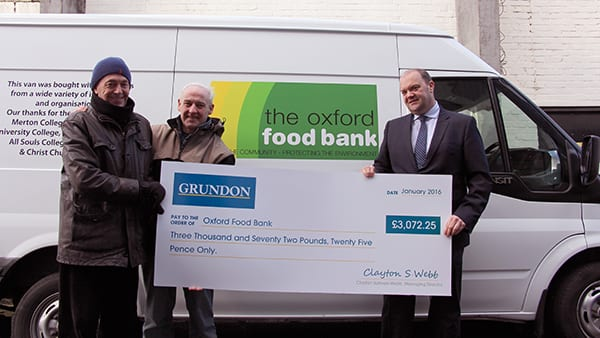 Food for thought - Grundon's Clayton Sullivan-Webb (far right) presents Oxford Food Bank co-founders Robin Aitken MBE (left) and David Cairns MBE with a cheque for over £3,000.